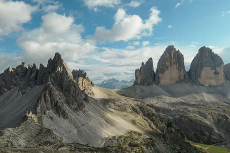A panoramic capture of the famous Tre Cime di Lavaredo (Drei Zinnen) and surrounding mountains in Italian Dolomites. The mountains are surrounded by thick clouds. A lot of landslides. Serenity 스톡 콘텐츠