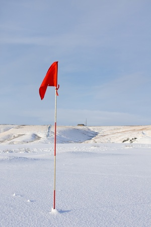 Red Golf Flag in the Snow Stock Photo - 8914224