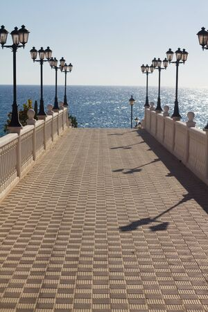 lampost: walkway to the sea with lamp posts
