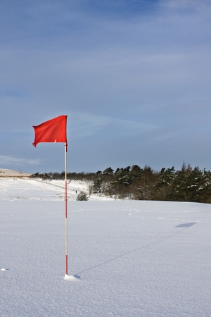 Golf Flag in snow Stock Photo