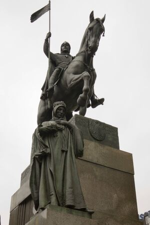 statue man on a horse and woman standing