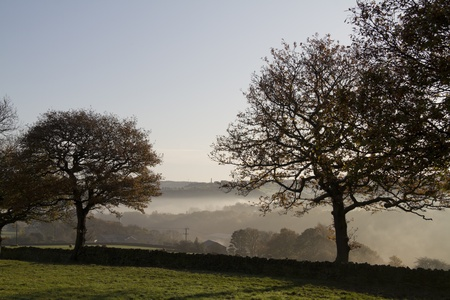 Mystic Dawn  misty Autumn morning in Halifax west yorkshire England