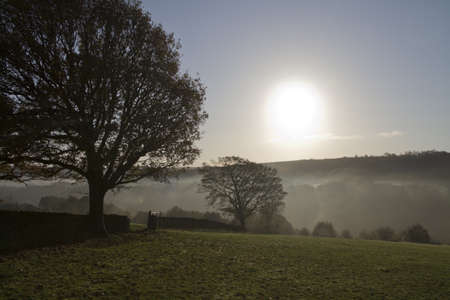 Mystic Dawn  misty Autumn morning in Halifax west yorkshire England photo
