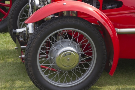 Vintage car wheel with a red body photo