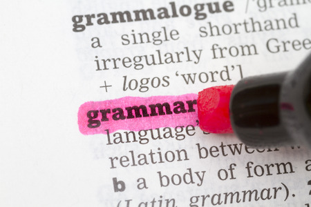 Grammar Dictionary Definition closeup highlighted in pink