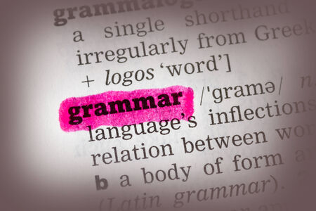 grammar: Grammar Dictionary Definition closeup highlighted in pink