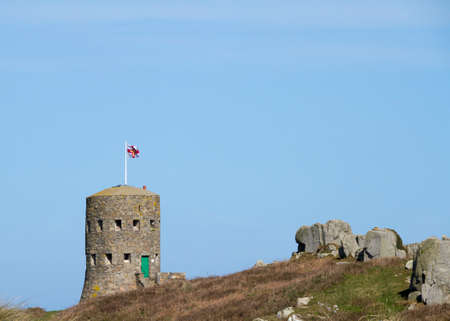 loophole: The British built 15 Guernsey loophole towers at various points along the coast of Guernsey between August 1778 and March 1779 to deter  possible French attacks