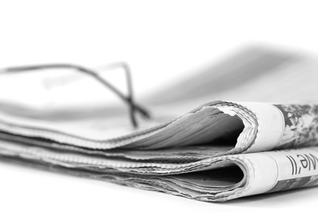 Newspaperfolded up on a white background