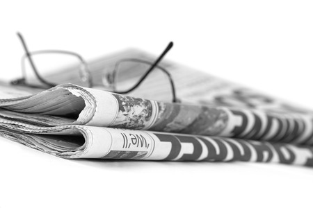 Newspaperfolded up with specs
