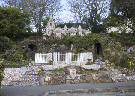 english famous: Little Chapel (Brother Deodat, 1914) in Saint Peter Port is possibly the smallest chapel in the world - miniature version of famous grotto  and basilica at Lourdes in France. Guernsey, English Channel.