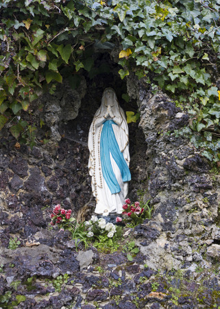 bailiwick: Little Chapel (Brother Deodat, 1914) in Saint Peter Port is possibly the smallest chapel in the world - miniature version of famous grotto  and basilica at Lourdes in France. Guernsey, English Channel.