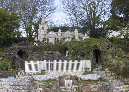 Little Chapel (Brother Deodat, 1914) in Saint Peter Port is possibly the smallest chapel in the world - miniature version of famous grotto  and basilica at Lourdes in France. Guernsey, English Channel.