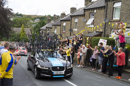 Greetland, England, JUL 06:Team Sky car driving up Hullen edge lane during the stage 2 of Le Tour de France on July 06 2014 in Greetland, England. Editorial
