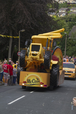 mc: Greetland, England, JUL 06: Mc cain vehicle during the passing of the publicity caravan on Hullen edge lane during the stage 2 of Le Tour de France on July 06 2014 in Greetland, England.
