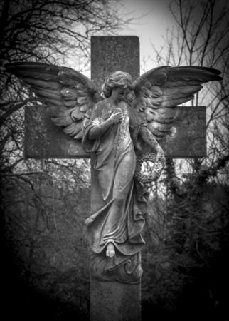 Angel on a Cross hand on heart.