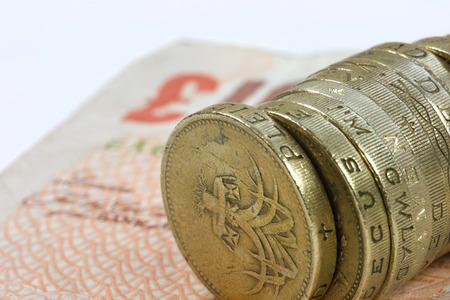 One pound coins on the edge on a white background Stock Photo