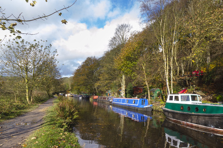 house float on water: Barge on the canal in autumn England UK