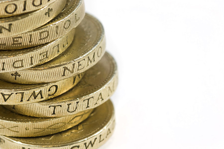 Stack of One pound coins on a white background