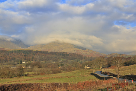 typically english: Lake District in autumn low clouds over the hills Stock Photo
