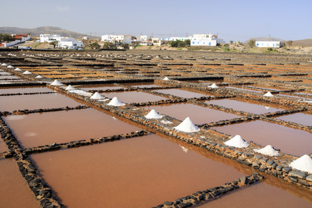knoll: Traditional methods of sea salt production. Salinas del Carmen, Fuerteventura
