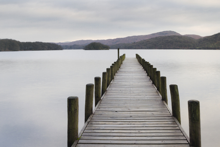 lake district: Scenic Wooden jetty on a lake in the lake district Stock Photo