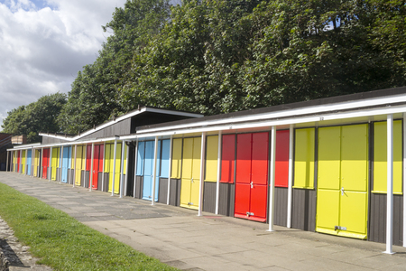 chalets: Beach chalets on the royal parade at Filey North Yorkshire UK Stock Photo