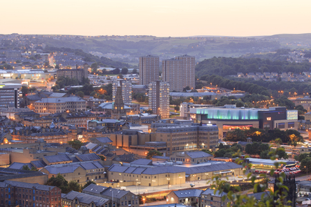 vue: Halifax, England - august 12th, 2015: Halifax town centre at dusk with the vue cinema at broad street plaza  12th august, 2015 in Halifax in west Yorkshire, England