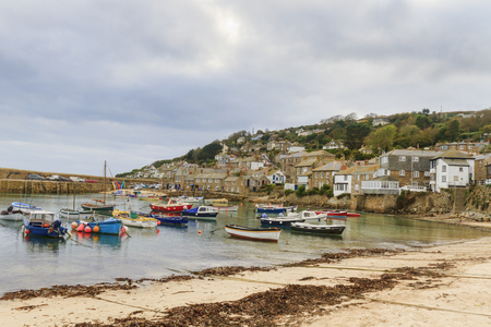 mouse hole: Mousehole ,Cornwall - October 22, 2014. Historic fishing harbour Mousehole Cornwall England UK Editorial