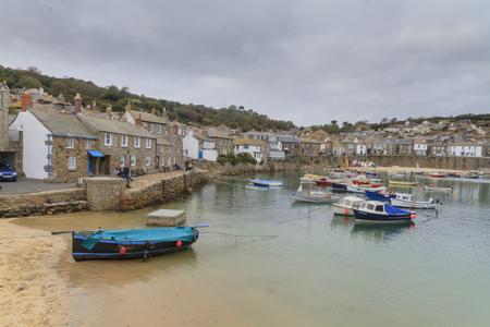 mousehole: Mousehole, Cornwall - October 22, 2014.  England UK Historic fishing harbour