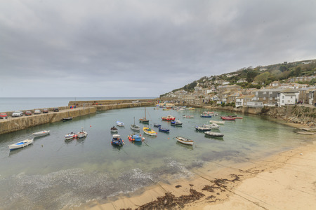 Historic fishing harbour Mousehole Cornwall England UK