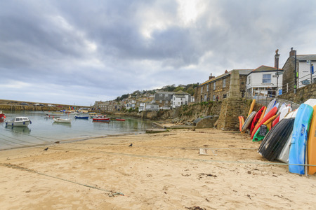 mousehole: Mousehole Cornwall - October 22, 2014. Historic fishing harbour Mousehole Cornwall England UK Editorial