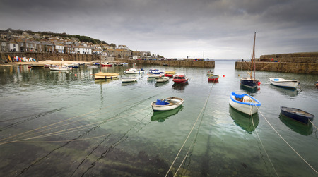 mousehole: Mousehole, Cornwall - October 22, 2014. Historic fishing harbour Mousehole Cornwall England UK Editorial