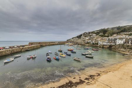 mousehole: Historic fishing harbour Mousehole Cornwall England UK