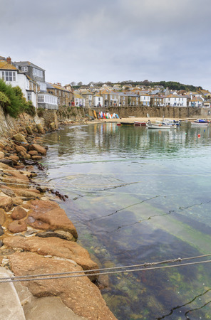 mousehole: Mousehole, Cornwall - October 22, 2014. Historic fishing harbour Mousehole Cornwall England UK Stock Photo