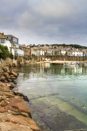 mouse hole: Mousehole, Cornwall - October 22, 2014. Historic fishing harbour Mousehole Cornwall England UK Stock Photo