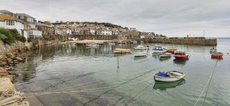 mouse hole: Mousehole, Cornwall - October 22, 2014. Historic fishing harbour Mousehole Cornwall England UK Editorial