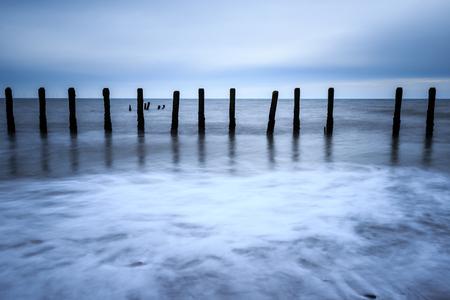 groynes: Wooden groynes on the beach with long exposure.