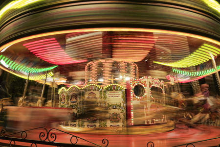 Motion blurr of vintage horse of amusement ride on merry-go-round carousel.