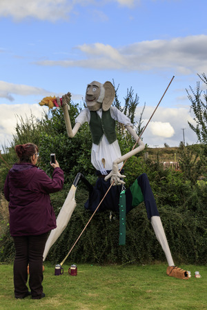 Norland, Halifax, West Yorkshire, UK 2nd September, 2016. Woman taking a photo of BFG, Norland Scarecrow Festival 2nd Sept - 5th Sept 2016. This years theme is �books� The Norland Scarecrow festival has been held every year since 2000 and raises money fo Editorial