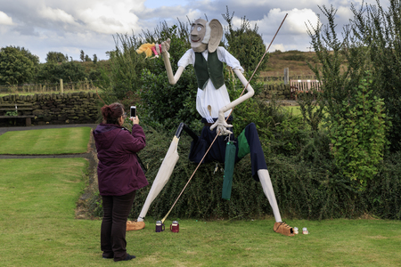 Norland, Halifax, West Yorkshire, UK 2nd September, 2016. Woman taking a photo of BFG , Norland Scarecrow Festival 2nd Sept - 5th Sept 2016. This years theme is �books� The Norland Scarecrow festival has been held every year since 2000 and raises money f Editorial
