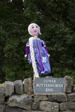 """Norland, Halifax, West Yorkshire, UK 2nd September, 2016. rapunzel, Norland Scarecrow Festival 2nd Sept - 5th Sept 2016. This years theme is """"books"""" The Norland Scarecrow festival has been held every year since 2000 and raises money for the village a"""