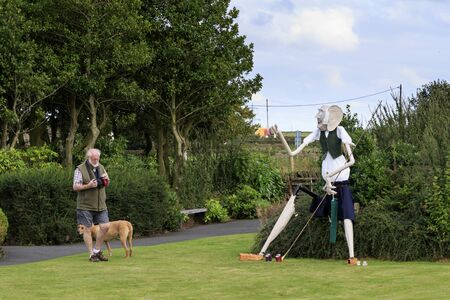 """Norland, Halifax, West Yorkshire, UK 2nd September, 2016. man just taken a photo of BFG. Norland Scarecrow Festival 2nd Sept - 5th Sept 2016. This years theme is """"books"""" The Norland Scarecrow festival has been held every year since 2000 and raises mo Editorial"""
