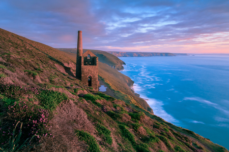 The coast at St Agnes in Cornwall with the Wheal Coates tin mine perched on the edge of the cliffs.
