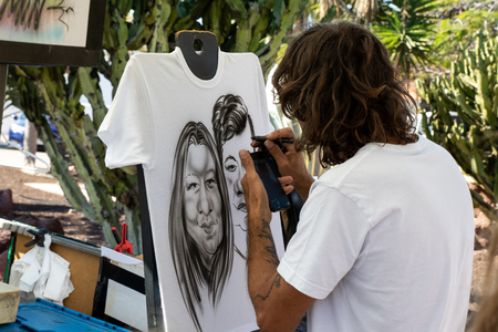 Fuerteventura, Spain - January 12, 2019: caricature artist at work in caleta de fuste, Fuerteventura, Spain Editorial