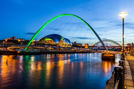 Newcastle and Gateshead at sundown showing Gateshead Millennium Bridge , sage and Tyne Bridges.