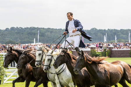 Harrogate, North Yorkshire, UK - July 12th, 2018: French horse trainer Lorenzo performing with his Horses at the Great Yorkshire Show on 12th July 2018 at Harrogate in North Yorkshire, England