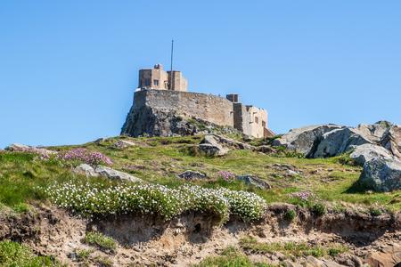 Lindisfarne castle on holy island in Northumberland, Holy Island is a tidal island off the northeast coast of England. Redakční