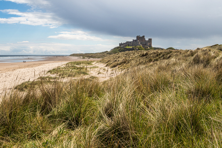 Bamburgh Castle is a castle on the northeast coast of England, by the village of Bamburgh in Northumberland