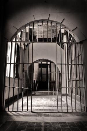 jailbreak: Black and white image of open prison-style bars