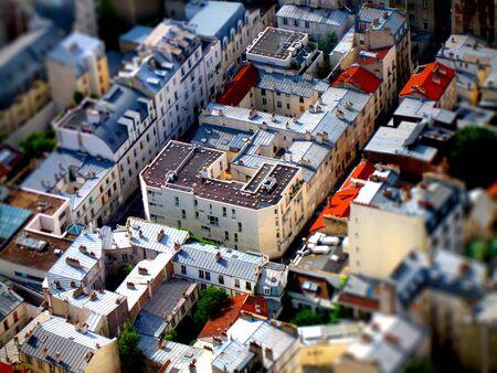 tilt shift: Aerial, tilt-shift view of a Parisian neighbourhood